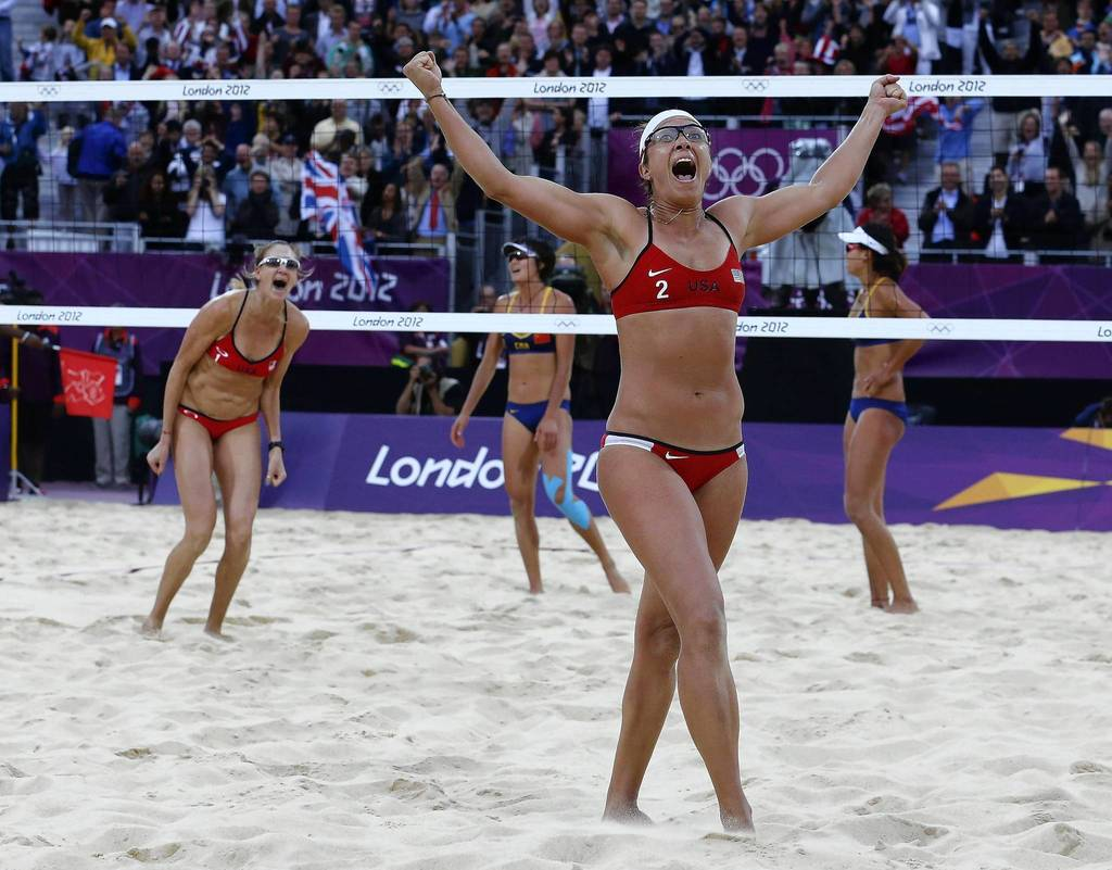 Misty May-Treanor and Kerri Walsh-Jennings celebrate winning their women's beach volleyball semifinal match against China's Xue Chen and Zhang Xi at Horse Guards Parade.