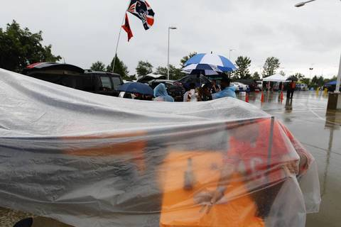 Bears fans attempt to tailgate in the rain.