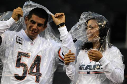 Bears fans Matt Zurbriggen and Andrea Levrio of Chesterton, Indiana try to stay dry.