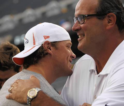 Ooffensive coordinator Mike Tice greets former Bears and current Broncos backup quarterback Caleb Hanie.