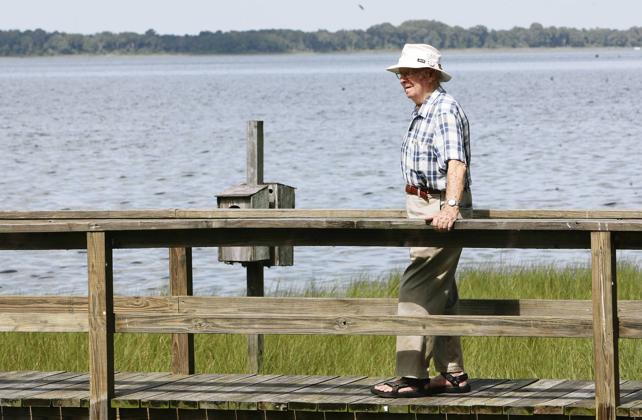 Robert Forbes of Tavares, 94, and a longtime Lakewatch volunteer, checks water levels on Lake Dora   daily.(Tom Benitez/Orlando Sentinel)