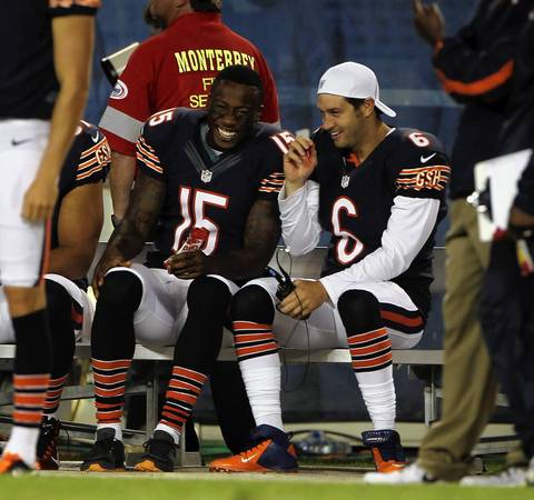 Brandon Marshall and Jay Cutler laugh on the bench in the 2nd quarter.