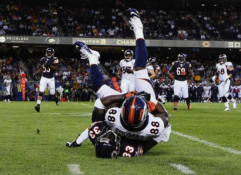 Charles Tillman tackles Broncos wide receiver Demaryius Thomas in the first quarter.