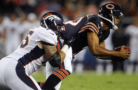 Defensive tackle Derek Wolfe stops quarterback Jason Campbell on a rush in the first quarter.