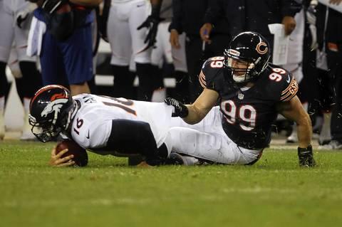 Defensive end Shea McClellin sacks Broncos quarterback Caleb Hanie in the first quarter.