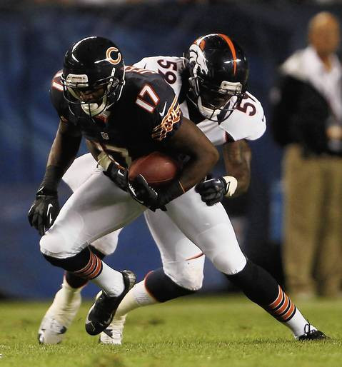 Rookie wide receiver Alshon Jeffery runs away from Broncos linebacker Danny Trevathan in the second quarter.