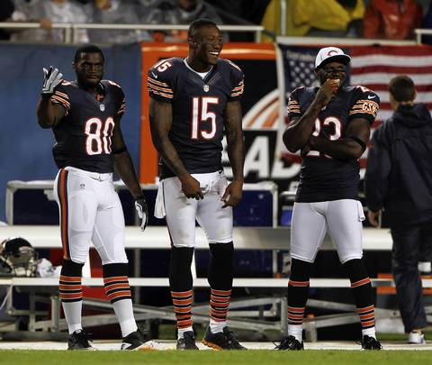 Wide receivers Earl Bennett, Brandon Marshall and Devin Hester on the sidelines.