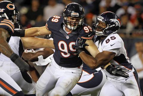 Defensive end Shea McClellin rushes against Broncos tight end Virgil Green in the third quarter.