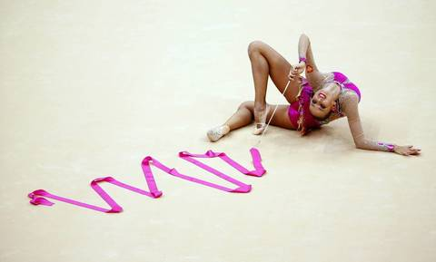 Russia's Daria Dmitrievai competes using the ribbon in her Individual All-around Rhythmic Gmnastics qualification match at the Wembley Arena.