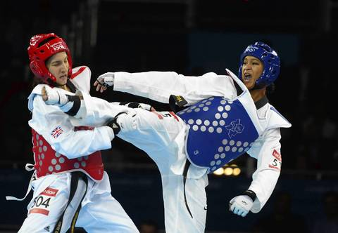 Paige McPherson (USA), right, competes against Sarah Stevenson (GBR) in the Women's 67kg Taekwondo preliminary round at the London 2012 Olympic Games.