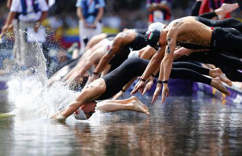 Athletes dive at the start of the Men's 10km Marathon swimming at Hyde Park during the London Olympic Games.