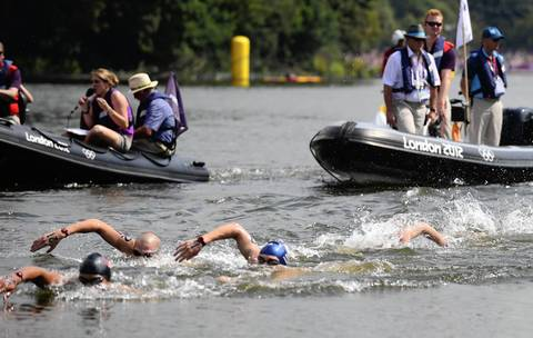 Swimmers compete in the Men's 10km open water swimming marathon at the London 2012 Olympic Games.