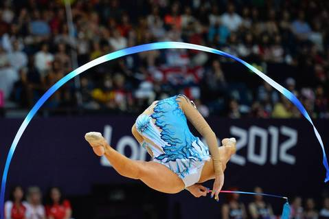 Cyprus' Chrystalleni Trikomiti performs her ribbon program during the Individual All-around qualifications of the Rhythmic Gymnastics event of the London Olympic Games.