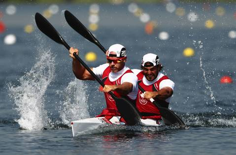Ryan Cochrane, left, and Hugues Fournel, of Canada, compete in the Men's Kayak Double (K2) 200m Canoe Sprint heats.