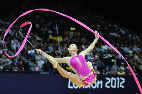 Russia's Daria Dmitrieva performs her ribbon program during the Individual All-around qualifications of the Rhythmic Gymnastics event of the London Olympic Games.