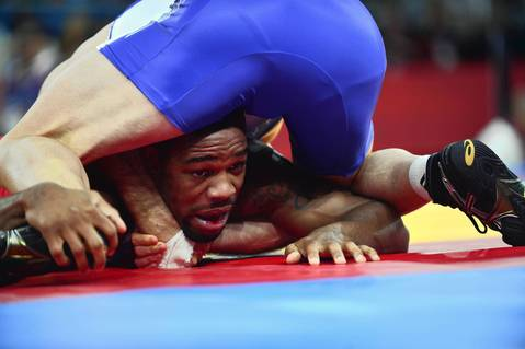U.S. wrestler Jordan Ernest Burroughs, bottom, wrestles Canada's Matthew Judah Gentry in their Men's 74kg Freestyle quarterfinal match.