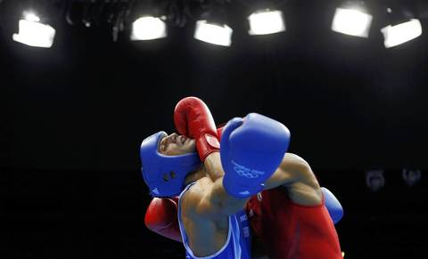 Cuba's Roniel Iglesias Sotolongo, right, fights Italy's Vincenzo Mangiacapre in the Men's Light Welter (64kg) semifinal boxing match at the London Olympic Games.