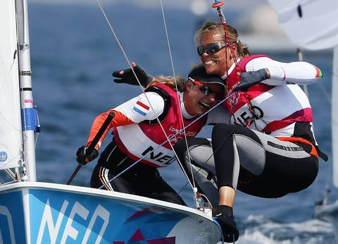 Netherlands' Lisa Westerhof and Lobke Berkhout celebrate as they cross the finish line to win bronze in the Women's 470 Sailing class at the London 2012 Olympic Games in Weymouth and Portland, southern England.