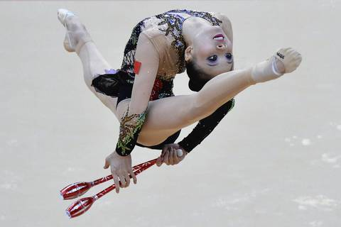 China's Deng Senyue performs her clubs program during the Individual All-around qualifications of the rhythmic gymnastics event of the London Olympic Games.