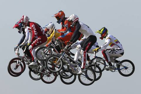 BMX racers takes a jump in the Men's BMX Cycling Final on Day 14 of the London 2012 Olympic Games.