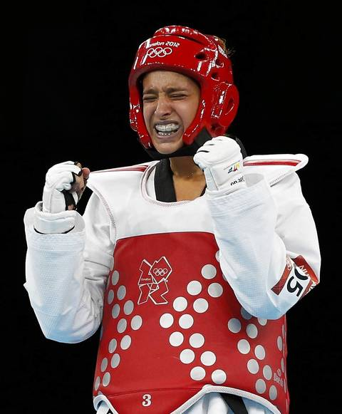 Turkey's Nur Tatar celebrates after beating Australia's Carmen Marton during their Women's 67kg semifinal Taekwondo match at the ExCel venue.