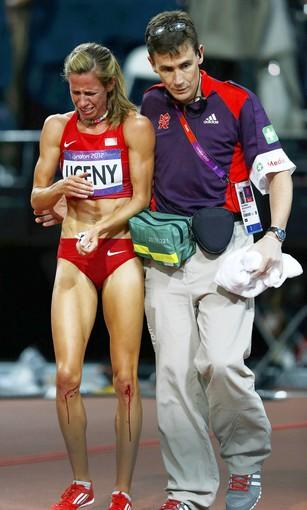 Morgan Uceny of the U.S. is helped off the track by a medic after falling during the 1500m final.