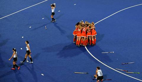 Netherlands captain Maartje Paumen celebrates with teammates after defeating Argentina 2-0 in the gold medal match.