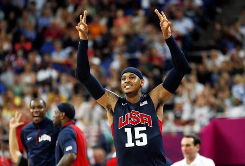 Carmelo Anthony celebrates after a made three-point basket against Argentina during their semifinal game.