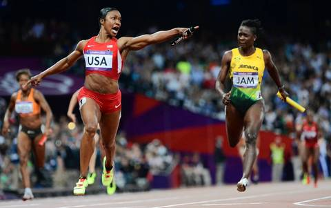 Carmelita Jeter and the U.S. team wins the women's 4 x 100m relay final in world record time.