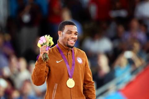 U.S. gold medal winner Jordan Ernest Burroughs poses on the podium of the Men's 74kg Freestyle.