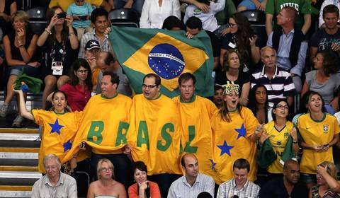 Fans of Brazil cheer during the men's semifinal volleyball match against Italy at Earls Court.