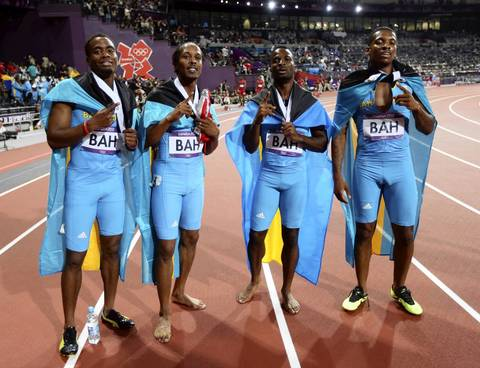 Bahamas' Chris Brown, Demetrius Pinder, Michael Mathieu and Ramon Miller celebrate winning their replay heat.