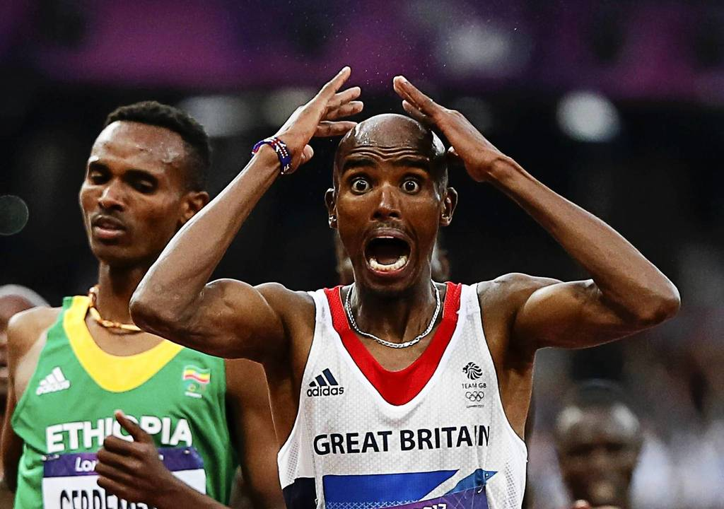Britain's Mo Farah reacts as he wins the men's 5000m final at Olympic Stadium.