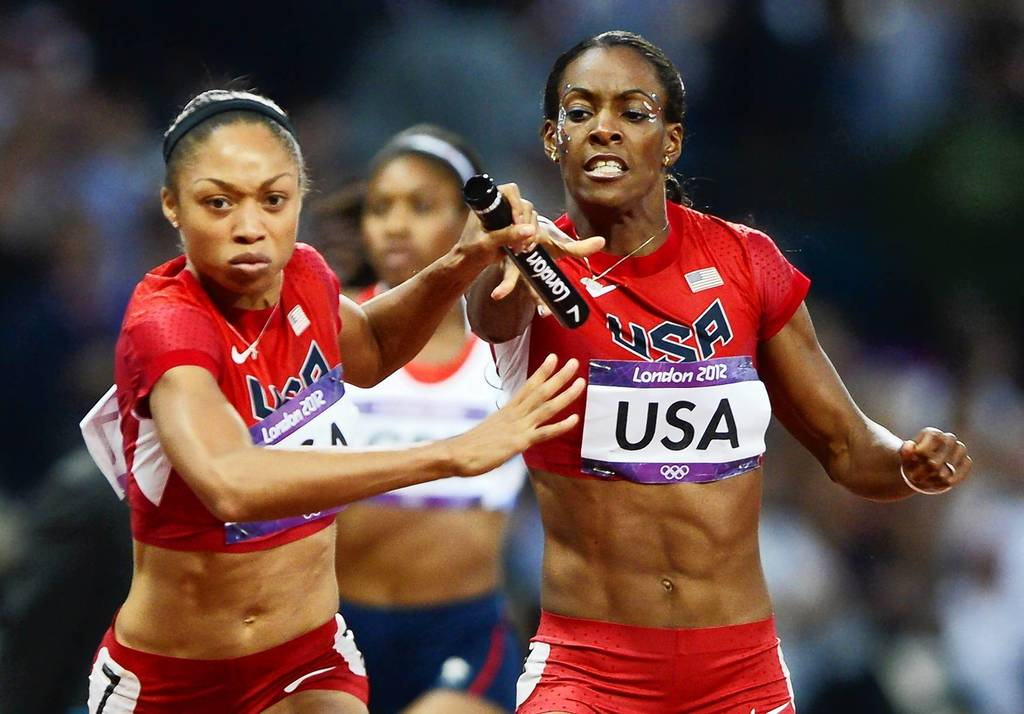 Allyson Felix takes the baton from U.S. teammate DeeDee Trotter in the women's 4x400m relay final.