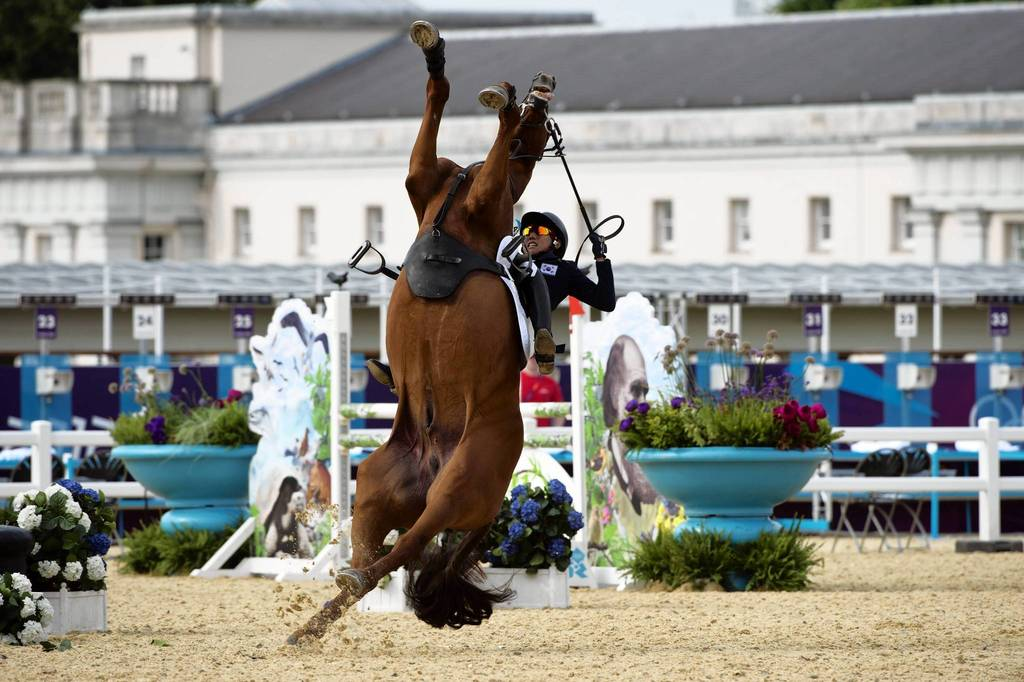 South Korea's Hwang Woojin loses control of his horse Shearwater Oscar during the Show Jumping event of the modern pentathlon.