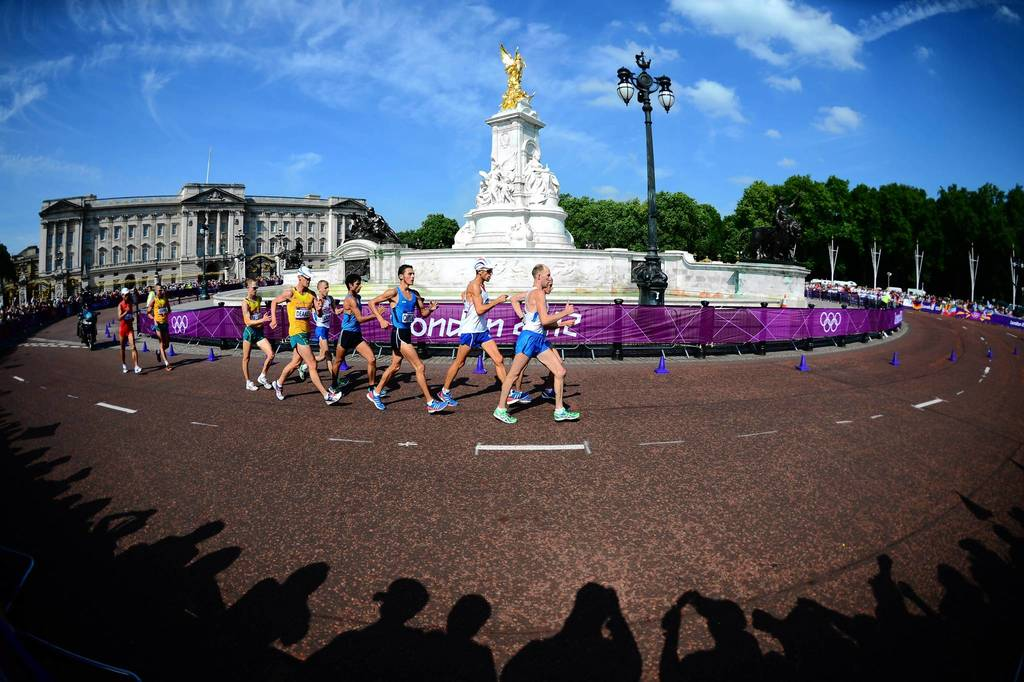 Russia's Sergey Kirdyapkin leads the pack as they walk past Buckingham Palace during the men's 50km race walk.