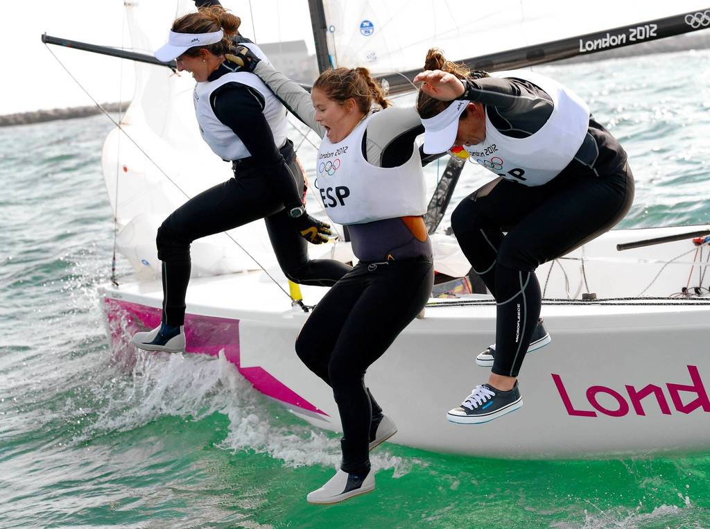 Spain's Angela Pumariega Menendez, Sofia Toro Prieto Puga and Tamara Echegoyen Dominguez leap into the water after winning gold in the women's sailing Elliott 6m event.