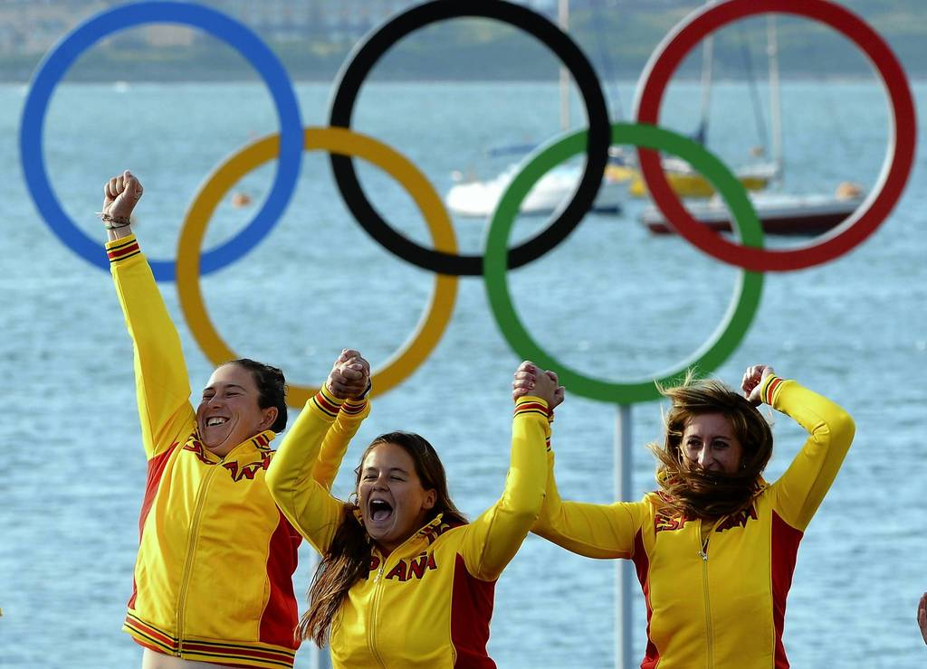 Spain's Angela Pumariega Menendez, Sofia Toro Prieto Puga and Tamara Echegoyen Dominguez celebrate on the podium after winning gold in the Elliott 6m sailing class.