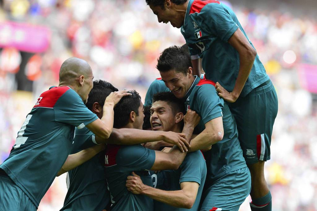Mexico's Oribe Peralta celebrates with teammates after he scored his team's second goal in the gold medal soccer match against Brazil at Wembley Stadium.