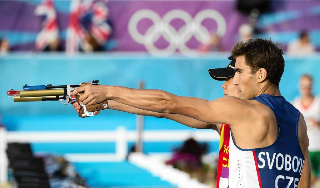 Czech Republic's David Svoboda (R) and China's Cao Zhongrong shoot at their targets in the men's Modern Pentathlon.
