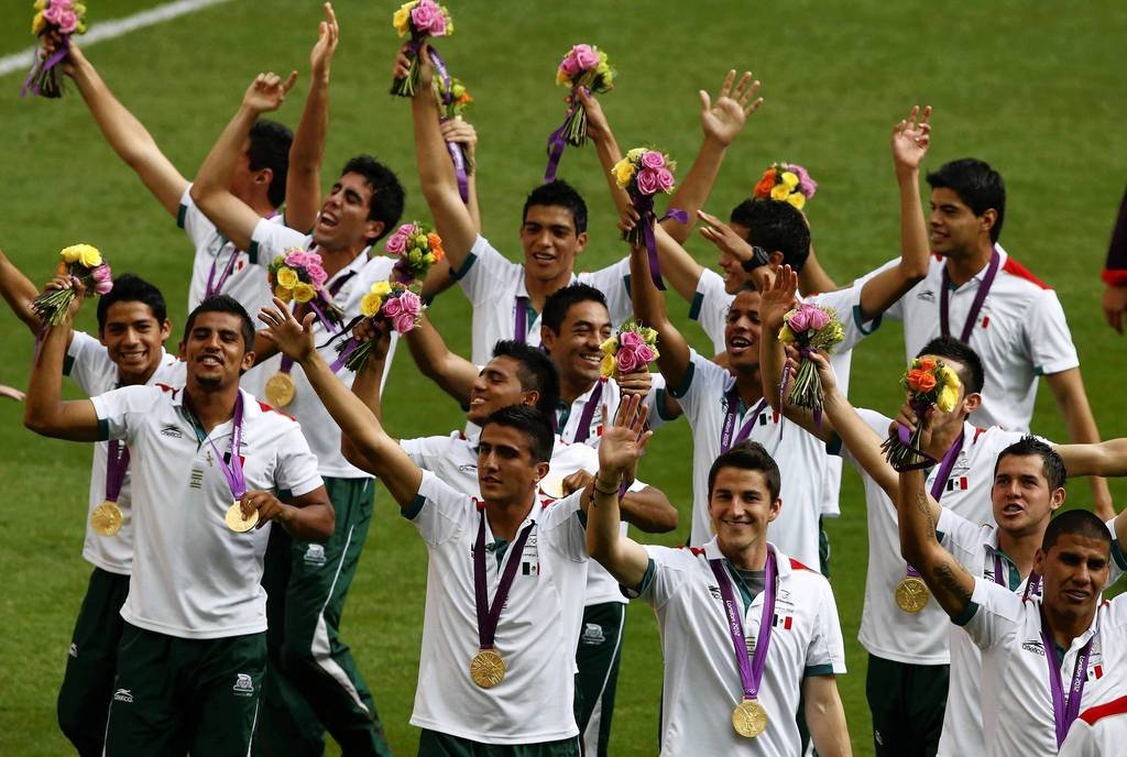 Mexico's players celebrate winning the gold medal after defeating Brazil in their men's gold medal match at Wembley Stadium.