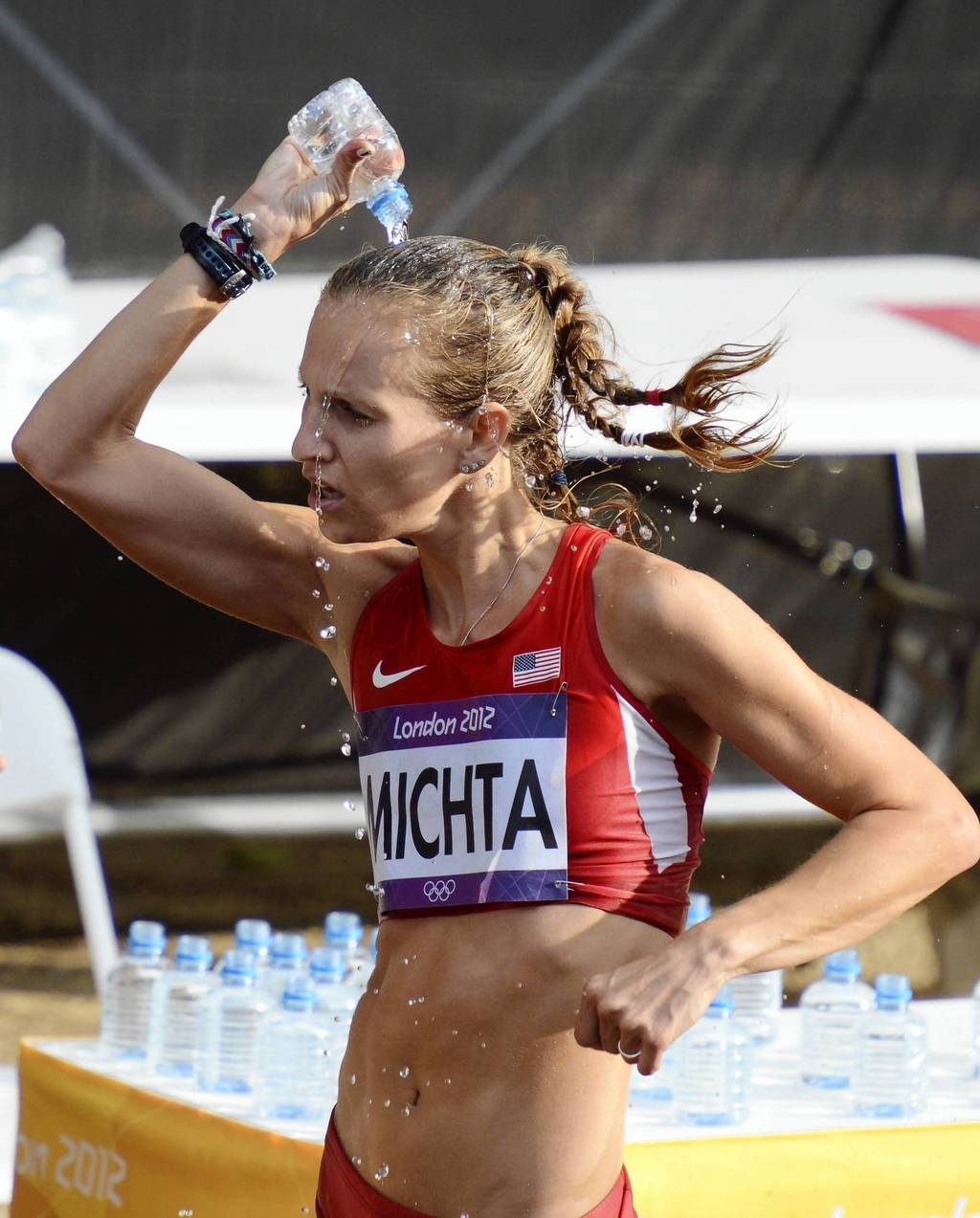Maria Michta (USA) pours water on her head during the women's 20km race walk during the London 2012 Olympic Games at The Mall.