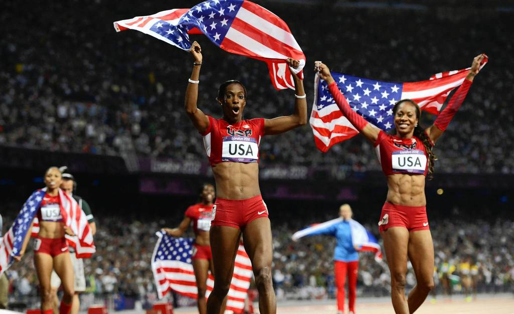 DeeDee Trotter and Sanya Richards-Ross celebrate after winning the gold in the women's 4x400m relay final.