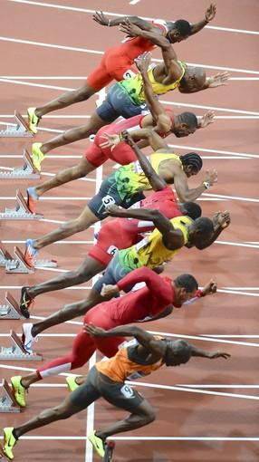 (Front to back) The Netherlands' Churandy Martina, US' Ryan Bailey, Jamaica's Usain Bolt, US' Justin Gatlin, Jamaica's Yohan Blake, US' Tyson Gay, Jamaica's Asafa Powell, Trinidad and Tobago's Richard Thompson compete in the men's 100m final.