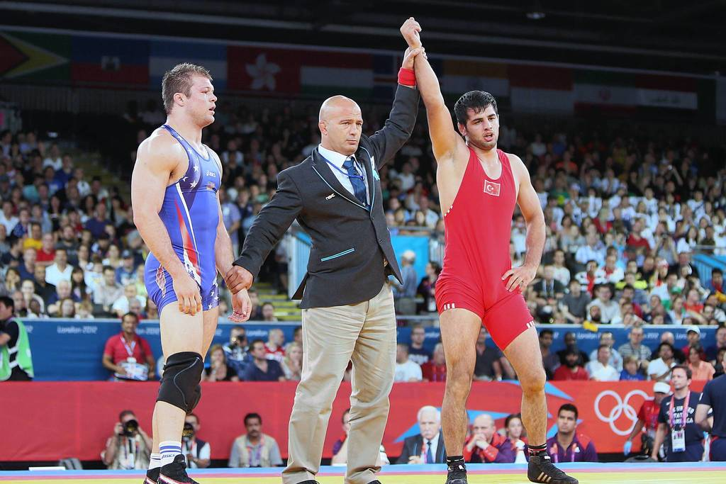 Turkey's Ibrahim Bolukbasi is declared the winner after defeating Jake Herbert of the U.S. in their Men's 84kg Freestyle repechage round 2 match.