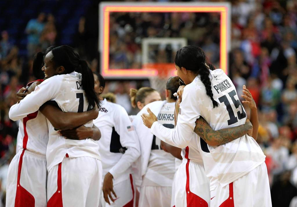 The U.S. women celebrate winning their 5th straight gold medal in basketball.