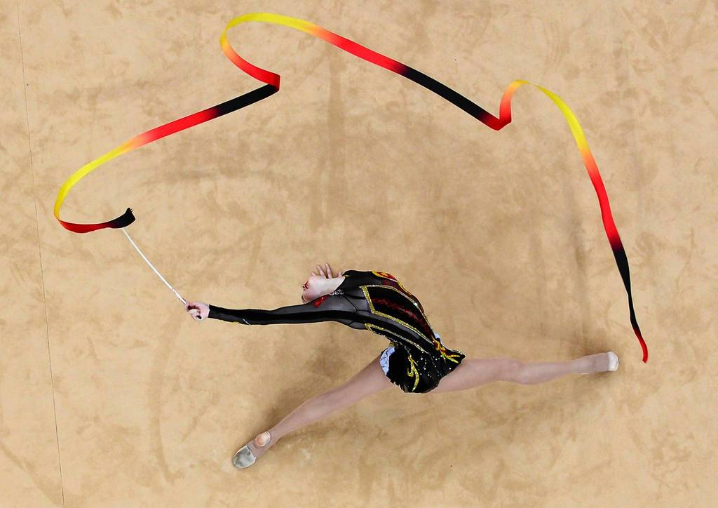 Ukraine's Alina Maksymenko performs her ribbon program during the individual all-around final of the rythmic gymnastics event. Russia's Evgeniya Kanaeva won gold while her compatriot Daria Dmitrieva took silver and Belarus' Liubou Charkashyna got bronze.