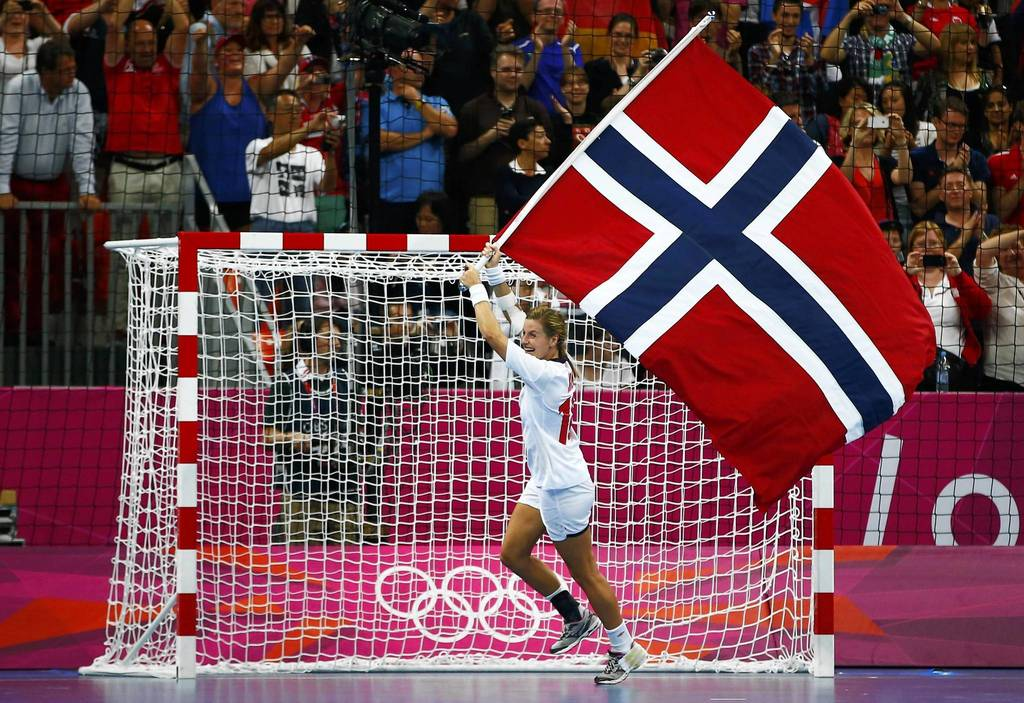 Norway's Linn-Kristin Koren celebrates after defeating Montenegro in their women's gold medal handball match at the Basketball Arena.
