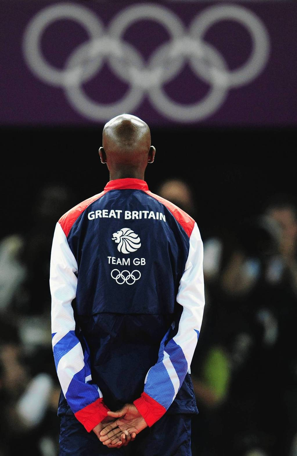 Gold medalist Mohamed Farah of Britain poses on the podium during the medal ceremony for the Men's 5000m.