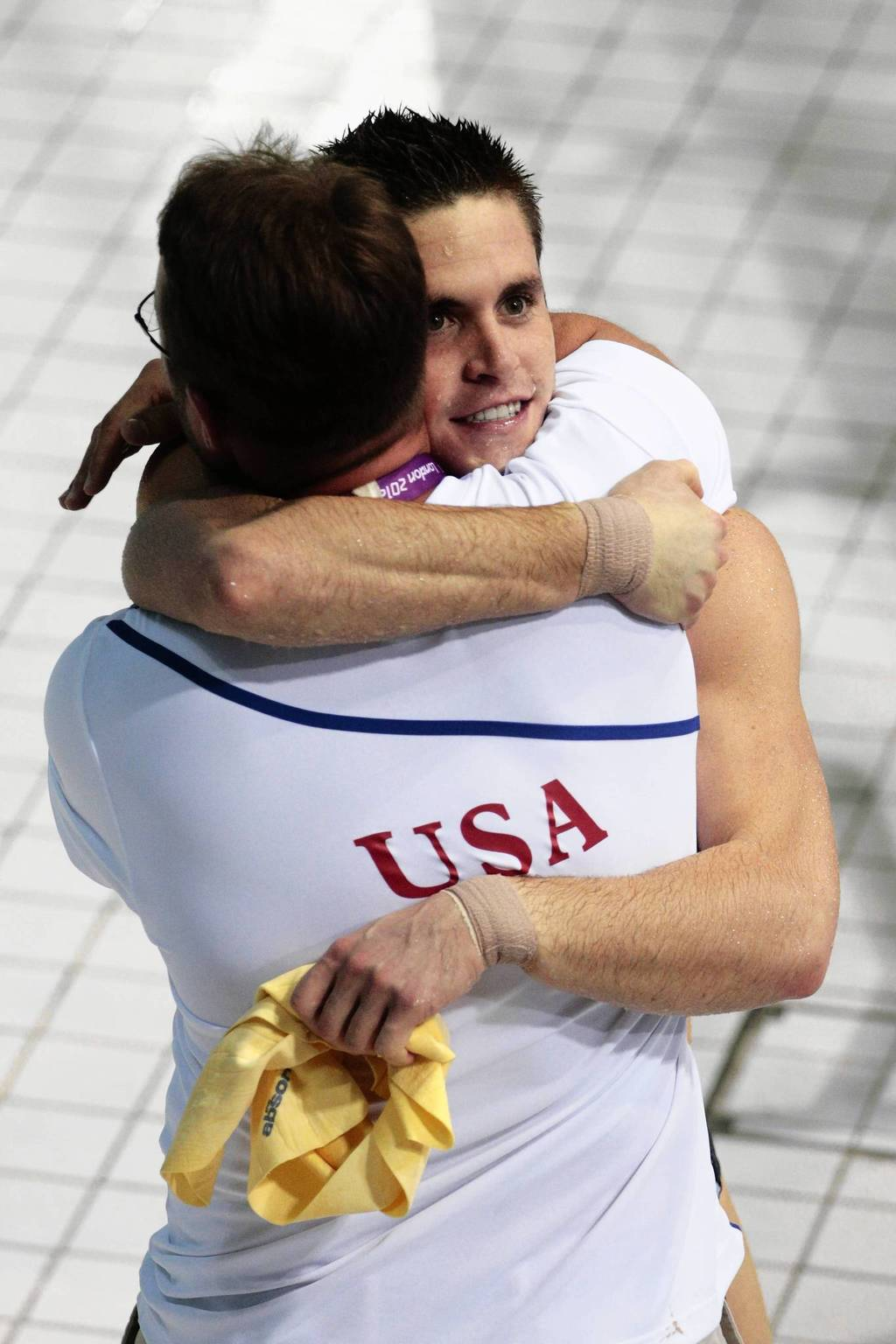 David Boudia of the United States celebrates with his coach Adam Soldati after winning the Men's 10m Platform Diving Final.